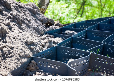 Scene of technology of strengthening the slope of a hill, mountain or ravine using plastic geogrid. Photos with an empty and already covered with soil geogrid closeup on a background with greenery