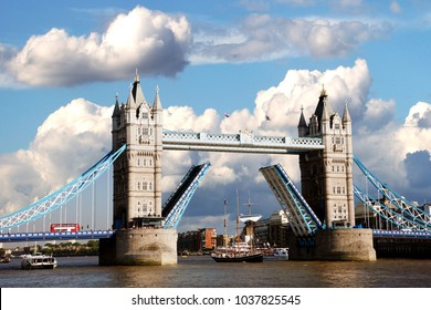 Scene of Tower Bridge, London's the most famous Bascule Bridge. Beautiful blue sky and dramatic white cumulus present in the background.