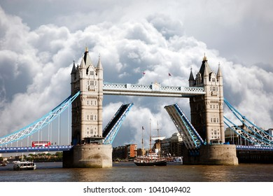 Scene of Tower Bridge, London's the most famous Bascule Bridge. Dramatic sky stormy cumulus clouds formation present in the background.