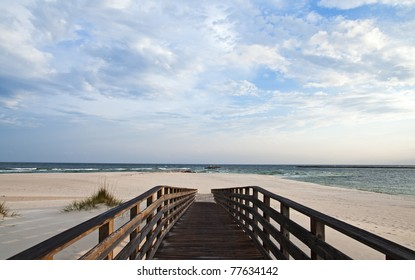 Scene of a walkway leading to the beach at Perdido Pass on the Alabama Gulf Coast.