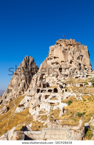 The scenenary from the region of famous Fairy Chimneys in Turkey. Uchisar Castle located on the outskirts of Uchisar.