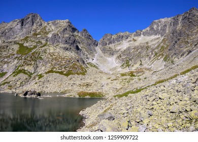Sceneric view of High Tatras, lake with clear water and high peaks/summits. The High Tatras or High Tatra Mountains are a mountain range along the border of northern Slovakia. National park.