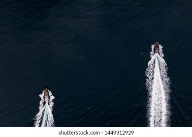 Scenery above view of two speedboats with wake on the dark sea surface