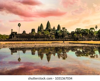 Scenery of Angkor Wat across the lake and the reflection in the water during sunrise. UNESCO world heritage site in Cambodia
