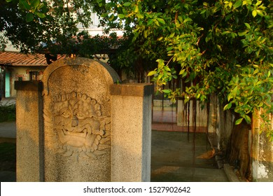 Scenery of Anping Sword Lion ( Foreigner Sword Lion ) on washed granolithic wall in Anping districtin Tainan, Taiwan.