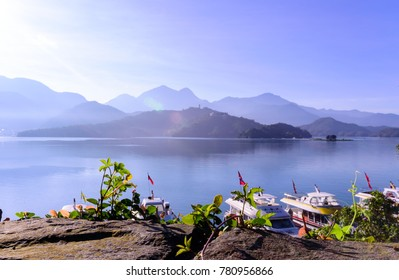 Scenery of Beautiful morning with sky reflect in the Sun Moon Lake, Landscape of Landmark famous attraction in Taiwan, Nantou. Travel in  nature Asia concept.