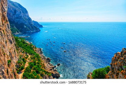 Scenery with Capri Island with Faraglioni of Italy at Naples. Amalfi and Solaro mountain. Landscape with Blue Mediterranean Sea at Italian coast. Panorama of Anacapri in Europe. View in summer.