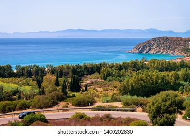 Scenery with car on the road at Mediterranean Sea in Villasimius in Sardinia Island in Italy in summer. View on Sardinian nature in Sardegna.