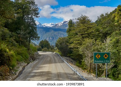 scenery at the carretera austral, a spectacular road leading to sout hchile in patagonia, the sign says cuves for the next 2 kilometers - Shutterstock ID 1939873891