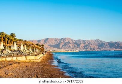 Scenery  of Eilat beach, Israel over Aqaba city, Jordan.