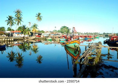 Scenery of a fishing village with beautiful reflection
