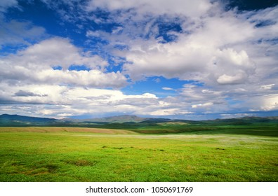 Scenery with a grass, clouds and mountains, Yukon, Canada
