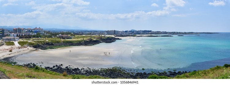 Scenery of Hamdeok Beach, view from Seoubong peak. It is one of the most famous beach in Jeju island , for clean and emerald-blue water and white sand.