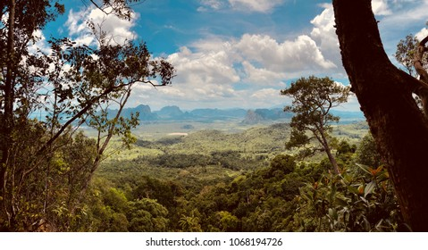 Scenery Heaven landscape. View from view point on a Natural landscape with the mountains, white clouds on the sky, and tropical jungle forest. Beautiful nature landscape panorama. Scenic nature.