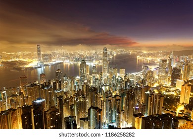 Scenery of Hong Kong before dawn, viewed from top of Victoria Peak, with a city skyline of crowded skyscrapers by Victoria Harbour & Kowloon area across the seaport ~ Cityscape of Hongkong in twilight