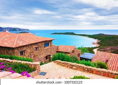 Scenery with Houses and Capo Coda Cavallo, San Teodoro in Olbia-Tempio province, Sardinia, Italy