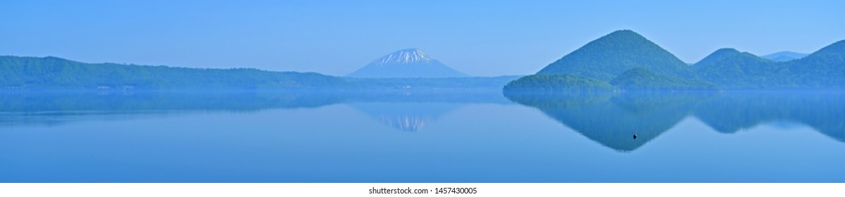 Scenery of inverted image of Mt. Ezo Fuji (Mt. Yotei) reflected in Lake Toya at Hokkaido