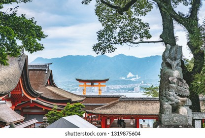 Scenery of the Itsukushima shrine in Hiroshima, Japan  (translation of the plate on torii gate: Itsukushima Jinja Shrine)