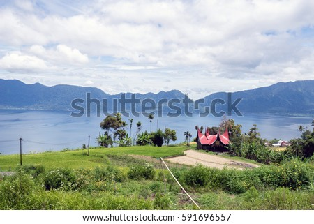 Scenery of Lake Maninjau, West Sumtra, Indonesia with traditional house beside the lake