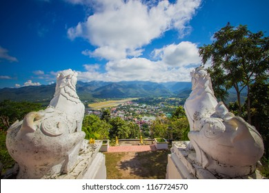 The scenery of Mae Hong Son town,Chong Kham Lake,the airport and forested hills of Burma as seen from Wat Phra That Doi Kong Mu,Mae Hong Son province,Northern Thailand.