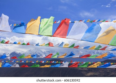 Scenery of Meili snow mountain with prayer flags, at the gate of Deqing city, Yunnan, China