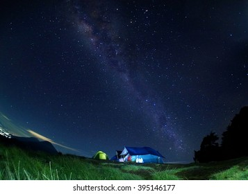 Scenery of milkyway with view of Mount Sindoro at the back. Image contains visible noise due to high ISO, soft focus, shallow DOF, slight motion blur.