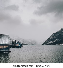 Scenery of mountain with lake and wooden cabin