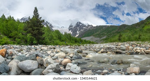 Scenery mountains in Svaneti, Georgia. Mountain river Adishtchala flowing from glacier Lardaad on mount Tetnuldi.