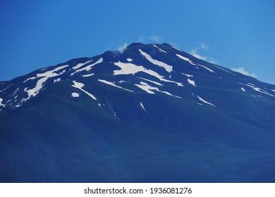 scenery of Mt.Chokai over the countryside, early summer in the Shonai Plain, Yamagata Prefecture, Japan