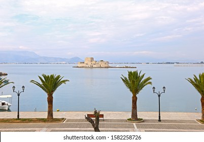 scenery of Nafplio town Argolis Greece - sidewalk of Nafplio with palm trees