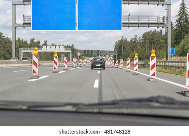 scenery on a german motorway with road construction zone in sunny summer ambiance