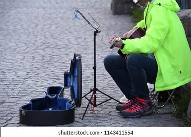 Scenery portrait of the part time music Busker in Hokkaido Japan