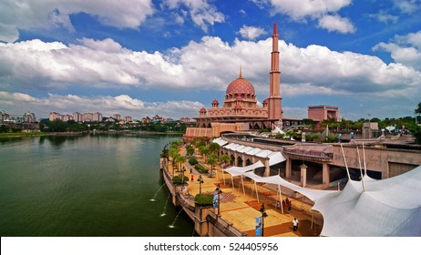 Scenery of Putra Mosque, Putrajaya Malaysia in hot sunny summer afternoon. (motion blur soft focus noise grain visible with aggression sharpening)