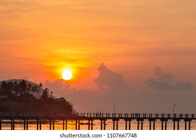 Scenery of Rawai pier with sky sunrise, Phuket, Thailand. This place is an amazing sunrise spot. Harbor bridge. Sea level lower.