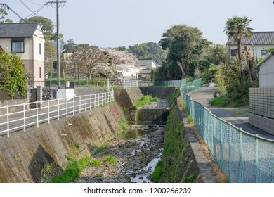Scenery of a river flowing through a residential area