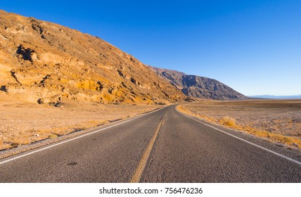 Scenery route through Death Valley National Park - lonesome road in the desert