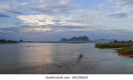 The scenery of the Salween river with the boat activities viewing from Mawlamyine town, Mon state, Myanmar.