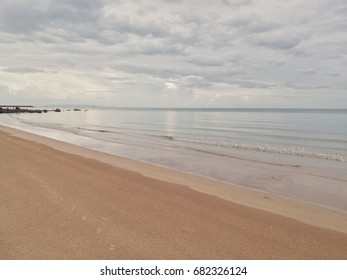 Scenery of seaside with sand, sea, and sky for relaxing time and holiday