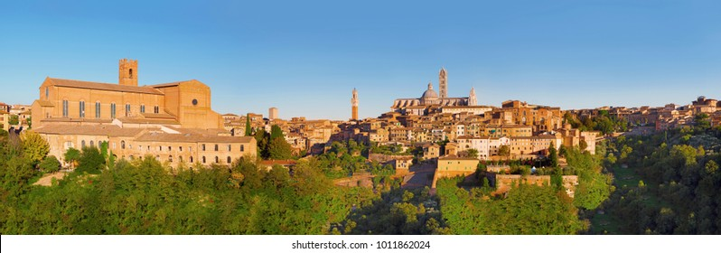 Scenery of Siena, a beautiful medieval town in Tuscany, with view of the Dome & Bell Tower of Siena Cathedral (Duomo di Siena), landmark Mangia Tower and Basilica of San Domenico, Italy