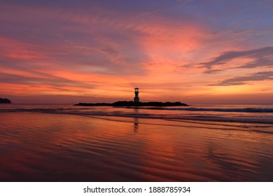 The scenery of the silhouette of Khao Lak lighthouse in sunset time with the dramatic twilight sky at Phang-Nga, Thailand. - Shutterstock ID 1888785934
