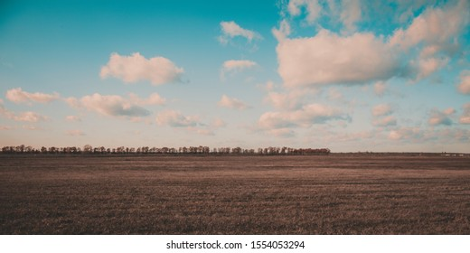 Scenery. Sky with clouds over the field. Ukrainian landscape. The background is natural.