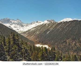Scenery of Snow mountain and valley at Huanglong or Yellow Dragon National park in winter in Sichuan province, China.