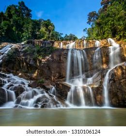 Scenery of Sungai Pandan Water Fall. Sungai Pandan Waterfall located 25 km from Kuantan town at Felda Panching Selatan Pahang. A slow shutter picture with soft water flow