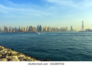Scenery view of Dubai Marina and Jumeirah Beach Residency (JBR) Skyscrapers at Arabian sea in Dubai, United Arab Emirates