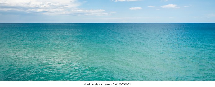 scenery view of transparent water and blue sky with horizont line