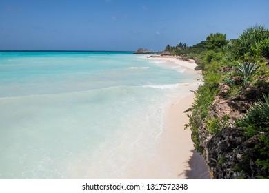 Scenery wild coast of Zanzibar Nungwi beach with white sand and azure water