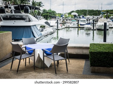Scenery at yacht marina with dining table