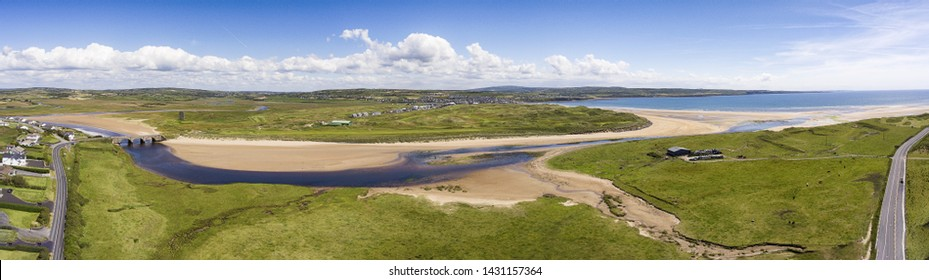 scenic aerial birds eye panoramic irish landscape from lahinch lehinch in county clare, ireland. beautiful lahinch beach and golf course that will host the 2019 Dubai Duty Free Irish Open