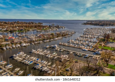 Scenic aerial panorama of Deale  waterfront docks on the Western Shore of Chesapeake Bay Maryland, dozens of luxury sailboats docking in the marina.