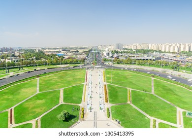 Scenic aerial view of Azadi Square and Lashkari Expressway in Tehran, Iran. Day traffic of Tehran. Amazing cityscape on sunny day. Azadi Square is a popular tourist attraction of the Middle East.